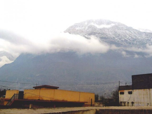 The mountains in Gilgit were covered in snow after the season's first snowfall. PHOTO: EXPRESS TRIBUNE